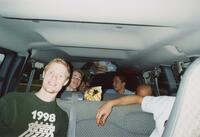 Augsburg men's cross country team runners in a van, circa 2000
