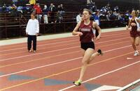 Augsburg women's track and field team runner running, circa 2000