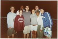Augsburg women's and men's track and field or cross country team runners taking a photo together, circa 2000