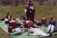 Augsburg women's track and field team runners relaxing, circa 2000