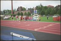 Augsburg men's track and field team runner during a race, 2002