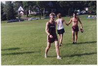 Augsburg men's cross country team runner walking, 2002
