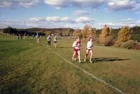 Augsburg women's cross country team runners during a race, circa 2000
