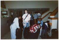 Augsburg women's cross country team runners standing by their luggage, circa 2000