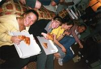 Augsburg women's cross country or track and field team runners eating pizza, circa 2000