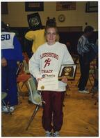 Augsburg women's cross country team runner holding an award, 1995