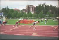 Augsburg men's track and field team runner at the beginning of a race, 2002