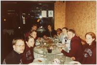 Augsburg women's and men's track and field and cross country team runners having pizza, circa 2000