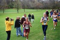 Augsburg women's cross country team runner running during the 2000 MIAC Championships, 2000