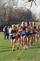 Augsburg women's cross country team runner during a race, circa 2000
