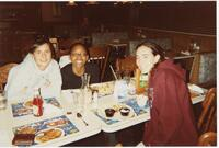 Augsburg women's cross country or track and field team runners eating a meal together, circa 2000