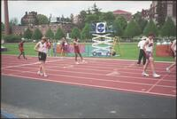 Augsburg men's track and field team runner standing on the track, 2002