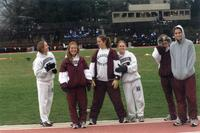 Augsburg women's track and field team runners taking a photo together on the track, circa 2000