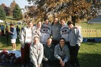 Augsburg women's cross country team runners taking a photo together, circa 2000
