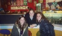 Augsburg women's cross country team runners taking a photo together in an ice cream parlor, circa 2000