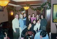 Augsburg women's cross country team takes photo with their coach, circa 2000