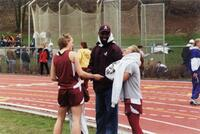 Augsburg women's track and field team runners laughing with coach, circa 2000