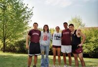 Augsburg women's and men's cross country team runners taking a photo together, circa 2000