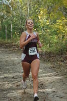 An Augsburg women's cross country team runner running in a race, 2001.