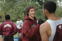 Augsburg cross country team runners getting dressed for a race, 2001.