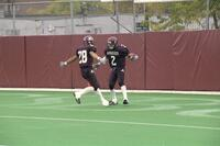 Two Augsburg men's football players celebrating together, 2001