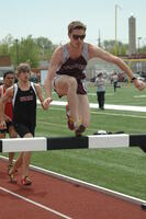An Augsburg men's track and field team hurdler in an event, 2010.