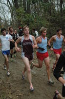 An Augsburg men's cross country team runner in motion during a race, 2001.