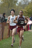 An Augsburg men's cross country team runner running in a race, 2001.