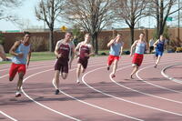 Augsburg men's track and field team sprinters in a race, 2010.