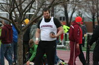 Augsburg men's track and field team player doing the shot-put, circa 2010