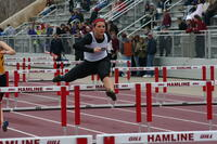 Augsburg women's track and field team runner doing hurdles, circa 2010
