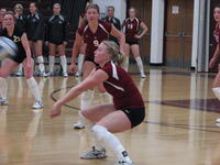 Augsburg women's volleyball player bumping the ball, circa 2005