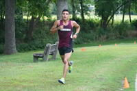 An Augsburg men's cross country team runner running in a race, 2013.