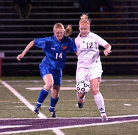 Augsburg women's soccer player running after ball, circa 2005