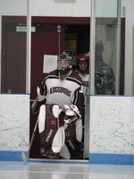 Augsburg women's hockey goalie walking onto the rink, circa 2005