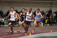 Augsburg men's track and field team runner running during a relay race, circa 2010