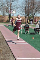 An Augsburg men's track and field team runner running in a long jump race, 2010.