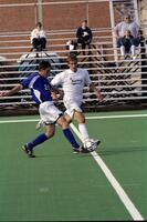 Augsburg men's soccer player tries to get soccer ball from rival player, 2001