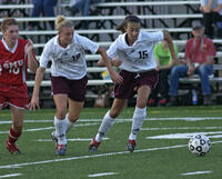 Augsburg women's soccer players running after the ball, circa 2005