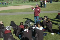 An Augsburg women's cross country team coach talking to the runners before a race, 2010.