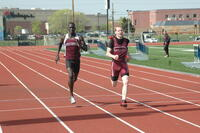 An Augsburg men's track and field team runner running in a race, 2010.