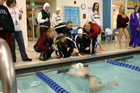 Augsburg women's swimming team members cheering on their teammate, circa 2005