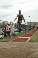 An Augsburg men's track and field team long jumper during an event, 2010.