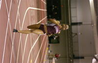 An Augsburg women's track and field team runner running in a race, 2005.