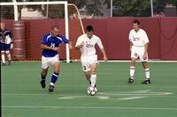 Augsburg men's soccer player running with the ball, 2001