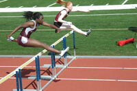 An Augsburg women's track and field team hurdler in an event, 2010.