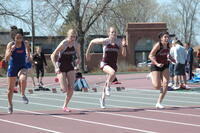 An Augsburg women's track and field team sprinter in a race, 2010.