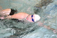 Augsburg women's swimming team member swimming, circa 2005