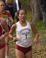 An Augsburg women's cross country team runner running in a race at the 2004 MIAC Championships, 2004.