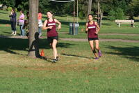 Augsburg women's cross country team runners running in a race, 2013.